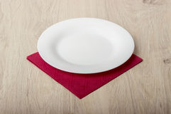 Empty white plate on wooden table royalty free stock images