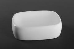 Empty white porcelain soap-dish Royalty Free Stock Photo