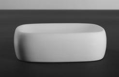 Empty white porcelain soap-dish Royalty Free Stock Image