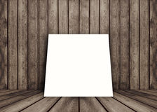Empty white poster frame put on old grunge texture wooden interior room for present product, perspective wooden floor and wall. Template for your content Stock Photo