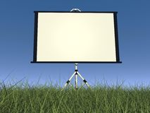 Empty white projector screen - 3D render. Empty white projection screen in nature with green grass and blue sky Royalty Free Stock Photos