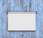 Empty white projector screen hanging from painting. Old wood wall Stock Photo