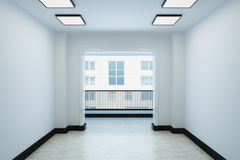 Empty white room with a balcony and interior decoration. The room contains lamps and plinth Royalty Free Stock Images