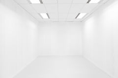 Empty white room and ceiling light royalty free stock photo