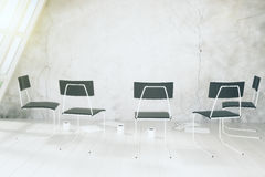 Empty white room with chairs, cups of coffee and othe accesories Royalty Free Stock Image