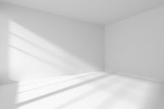 Empty white room corner with sunlight. Abstract architecture white room interior - empty white room corner with white walls, white floor, white ceiling with Stock Image