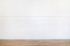 Empty white room with parquet floor and wood trimmed wall. Interior stock photos