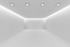 Empty white room with small round ceiling lamps. Abstract architecture white room interior - empty white room with white wall, white floor, white ceiling with Royalty Free Stock Photography