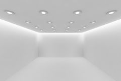Empty white room with small round ceiling lamps perspective view. Abstract architecture white room interior - empty white room with white wall, white floor Royalty Free Stock Image