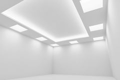 Empty white room with square ceiling lights wide diagonal view. Abstract architecture white room interior - empty white room with white wall, white floor, white Royalty Free Stock Photography