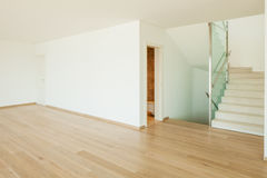 Empty white room with stairs. Empty room with stairs and parquet for the floor stock photography