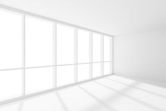 Empty white room with sun-light from large window. Business architecture white colorless office room interior - empty white business office room with white floor Royalty Free Stock Photo