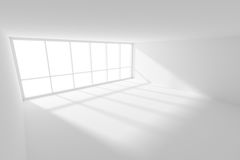Empty white room with sunlight from big window. Business architecture white colorless office room interior - empty white business office room with white floor Royalty Free Stock Photos