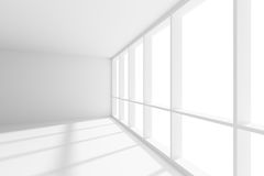 Empty white room with sunlight from wide large window. Business architecture white colorless office room interior - empty white business office room with white Stock Photos
