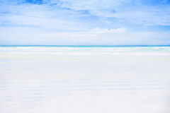 Empty white sand beach. Empty white sand beach with turquoise ocean and blue sky. Luxurious holiday and vacation traveling concept Royalty Free Stock Image