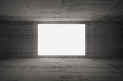 Empty white screen glows in dark concrete room. Empty white screen glows in dark abstract concrete room interior Stock Photos