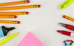 Empty white sheet of paper for your text with pencils, pink sticknotes, red pen, yellow and blue highlighters. royalty free stock images