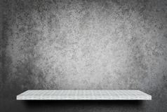 Empty shelf on gray cement wall background for product display stock images