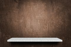 Empty shelf on grunge brown background for product display royalty free stock image