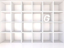 Empty white shelves with G Royalty Free Stock Image