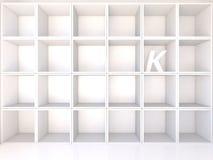 Empty white shelves with K Royalty Free Stock Photos