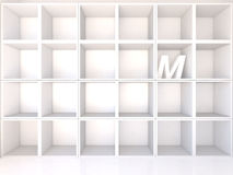 Empty white shelves with M Royalty Free Stock Image