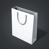 Empty white shop bag. Perspective view of empty white shop bag on black background Royalty Free Stock Images