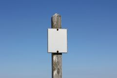 Empty White Sign on Wooden Signpost Royalty Free Stock Image