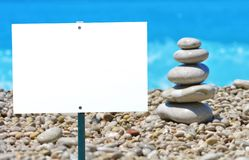 Empty white signboard with place for your information. On a sea background royalty free stock photo