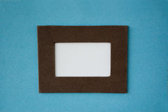 Empty white space with color frame. Empty white space with brown frame on blue background Royalty Free Stock Photo