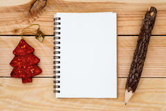 empty white space notebook with pencil and christmas ornament on Stock Photo