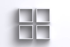 Empty white square frame shelf boxes on blank wall Stock Image