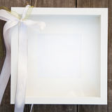 Empty White Square Picture Frame with Bow Stock Photography