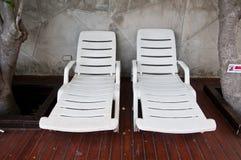 Empty white sunbeds Stock Photos