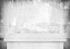 Empty white table next to blurred gray concrete wall.  royalty free stock photos