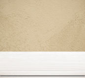 Empty white table over cement wall. Empty white table over brown cement wall background stock images