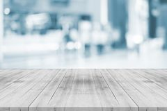 Empty white table top on blurred background from shopping mall,space for montage product royalty free stock photos