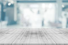 Empty white table top on blurred background from shopping mall,space for montage product royalty free stock image
