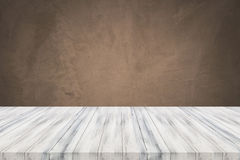 Empty white table top with concrete wall background. For product display stock photo