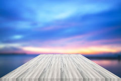 Empty white table top with sunset background. For product display stock images