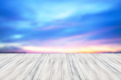 Empty white table top wooden with sunset background. For product display royalty free stock photo