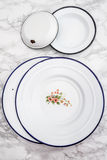 Empty White Vintage Enamel Plates with Flower Design Royalty Free Stock Photography