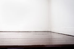Empty white wall and dark brown parquet floor in perspective vie Stock Photo