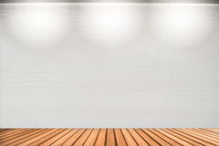 Empty white wall with 3 spot lights and wooden floor. stock images