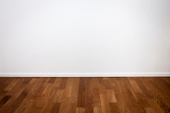 Empty white wall and wooden floor stock photo