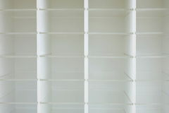 Empty white wooden rack shelves. In office Stock Photography