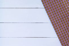 Tablecloth. Empty white wooden table covered with checkered tablecloth Stock Images