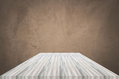 Empty white wooden table top with concrete wall background. For product display royalty free stock photo