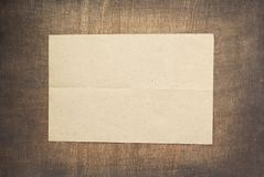 Empty white wrinkled paper at wood stock photos