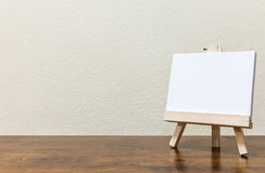 Empty whiteboard on the wooden table. Empty blank whiteboard on the wooden table Royalty Free Stock Photo